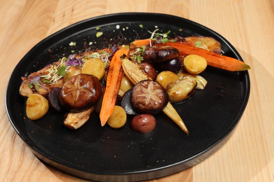 The veggie platter at Char'd is seasoned with miso and togarashi.