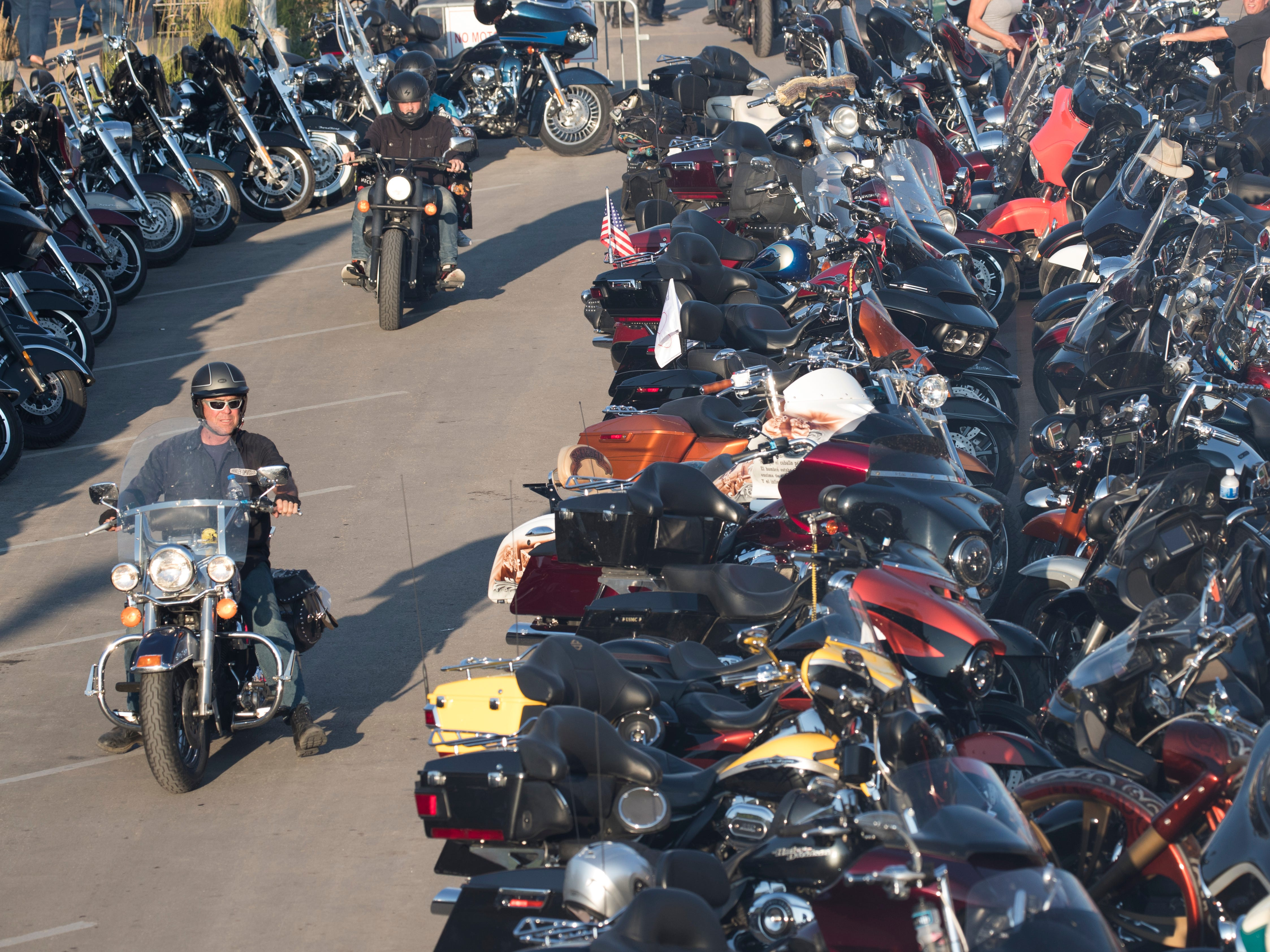 2018: Motorcyclists look for parking spaces downtown during the Sturgis Motorcycle Rally.