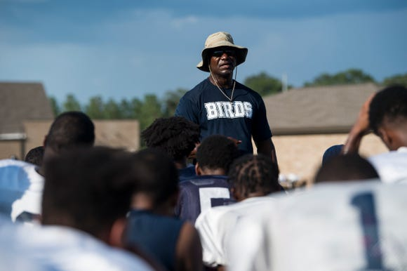 Coach Angelo Wheeler talks with his team after practice at Park Crossing High School in Montgomery, Ala., on Wednesday, Aug. 8, 2018.