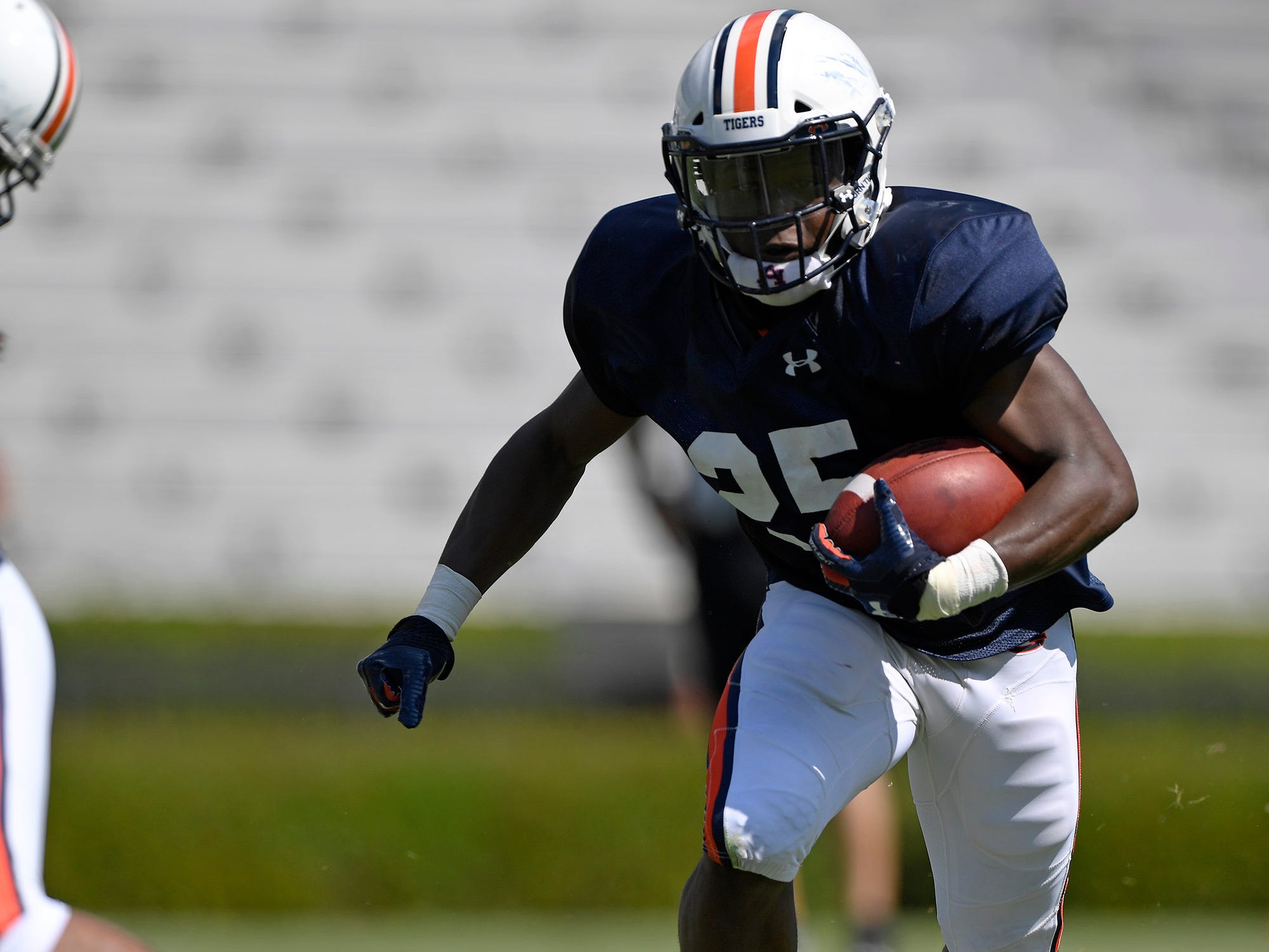 Auburn running back Shaun Shivers runs during a scrimmage on Thursday, Aug. 9, 2018 in Auburn, Ala.