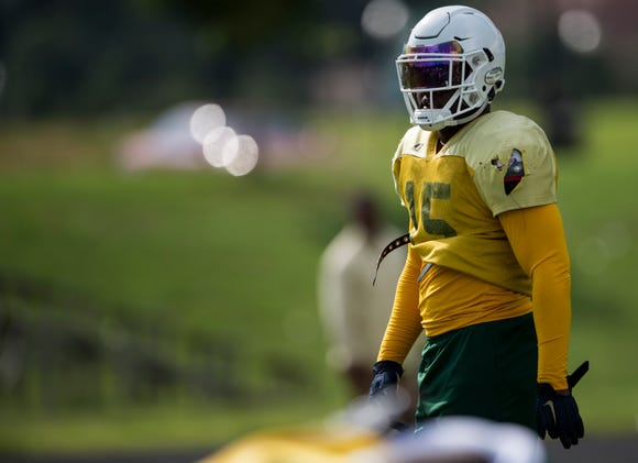 Linebacker Ke'Shun Brown (15) lines up for scrimmage during practice at Carver High School in Montgomery, Ala., on Thursday, Aug. 9, 2018.