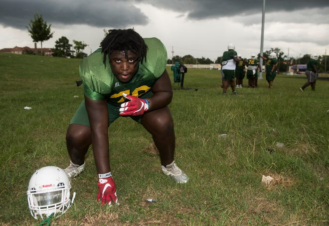 James Robinson poses for a portrait during practice at Carver High School in Montgomery, Ala., on Thursday, Aug. 9, 2018.
