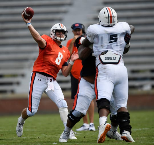 Auburn quarterback Jarrett Stidham throws under pressure Thursday. Auburn football scrimmage on Thursday, Aug. 9, 2018 in Auburn, Ala.