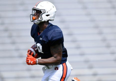 Auburn wide receiver Seth Williams makes a long run after a catch during a scrimmage on Thursday, Aug. 9, 2018 in Auburn, Ala.