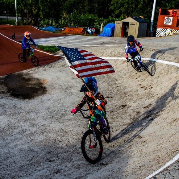 Sebastian Tranchand, 9, of Naples leads the pre-race ceremonial lap at the Naples BMX track in Golden Gate City on Wednesday, Aug. 8, 2018.