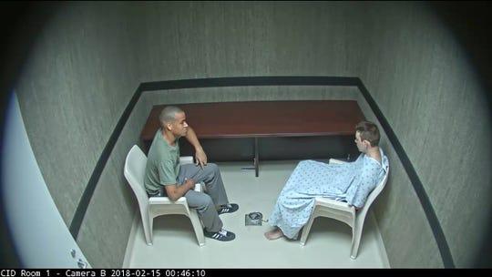 Screenshot of Nikolas Cruz, right, and Zachary Cruz, left, talking in a Broward Sheriff's Office interrogation room hours after the massacre at Marjory Stoneman Douglas High School in February.