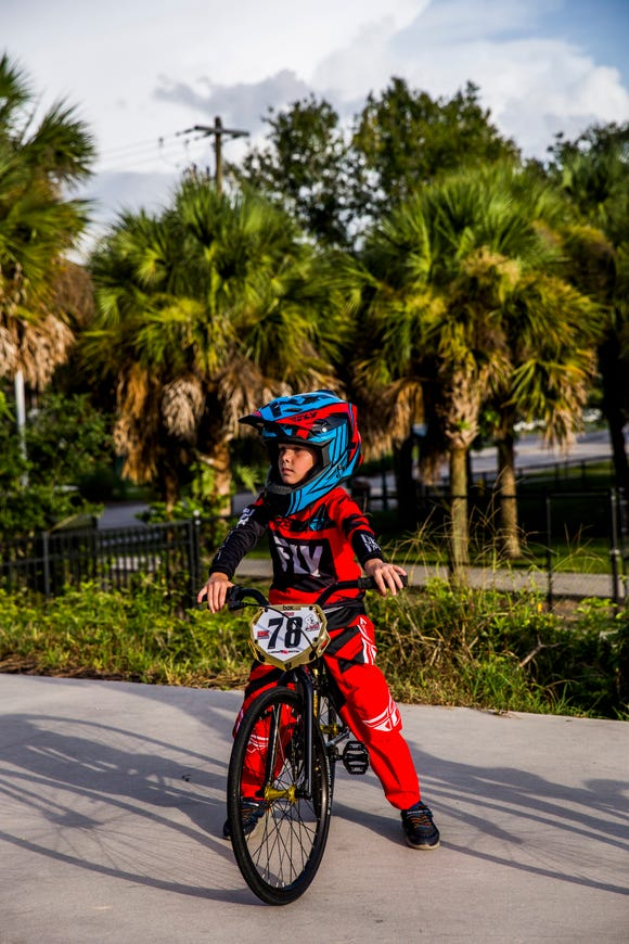 Trevor Jackson, 6, of Naples waits for his turn to race at the Naples BMX track in Golden Gate City on Wednesday, Aug. 8, 2018.