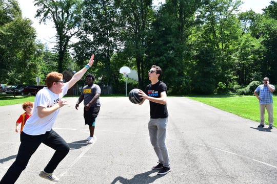 Parkland mass shooting survivor David Hogg plays basketballs with other activist at March for Our Lives tour in Morristown, NJ.