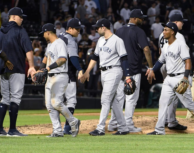 The New York Yankees celebrate a 7-3 win over the Chicago White Sox in a baseball game Wednesday, Aug. 8, 2018, in Chicago.