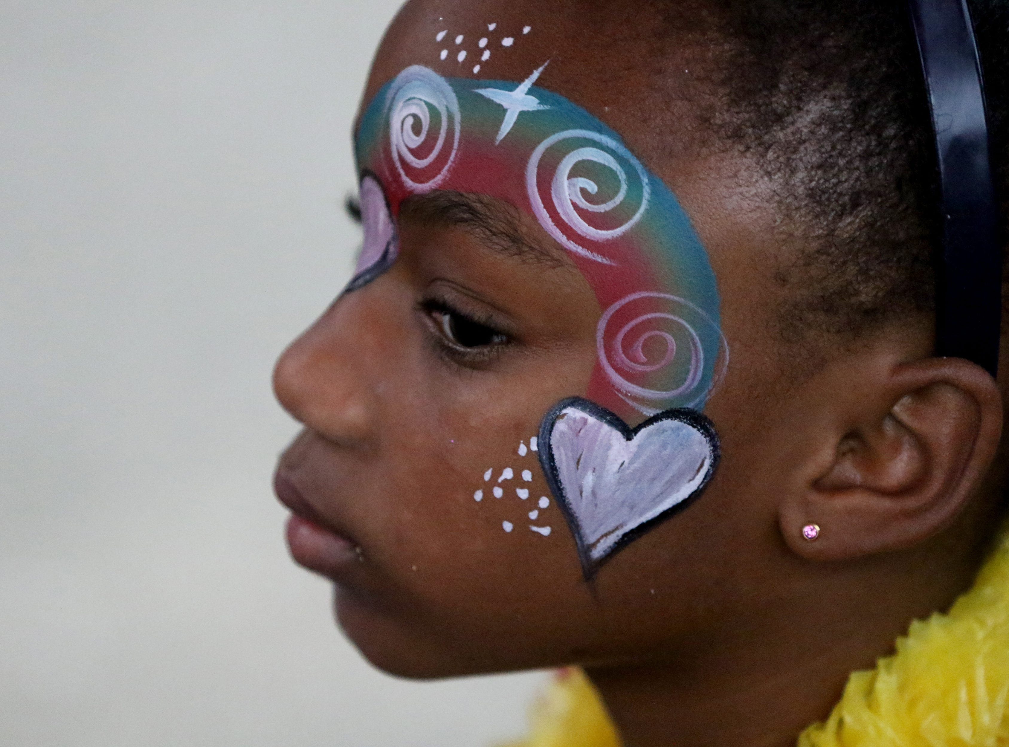 Justice Samuels, 7, is shown on Hamilton Ave. in Paterson after getting her face painted on National Night Out.  Tuesday, August 7, 2018