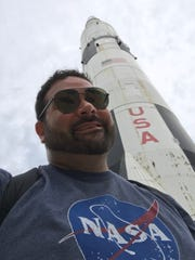 Corpus Christi teacher James Falletti with a rocket at the U.S. Space and Rocket Center in Huntsville, Alabama