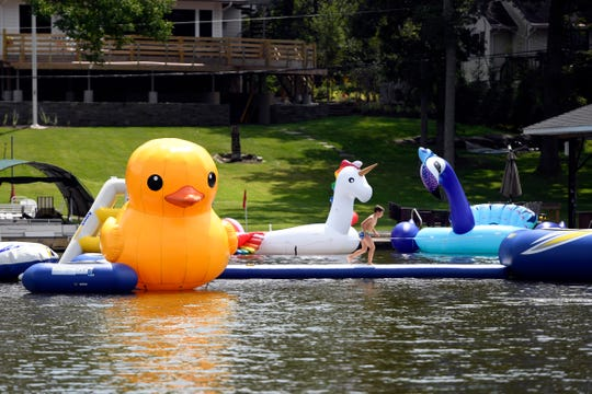 Giant inflatables and a mini waterpark seen in front of a Greenwood Lake resident's home on Wednesday, August 8, 2018.
