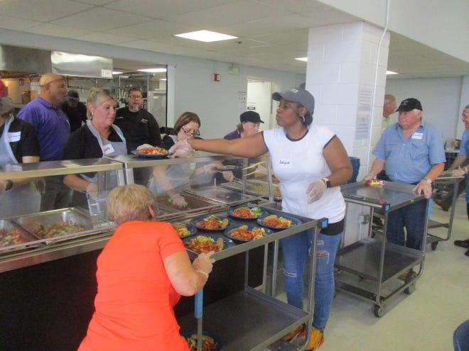 Members of the New Jersey Bankers Association volunteer at Paterson's Eva's Kitchen.