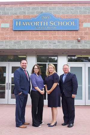 New staff members for Haworth School District started on the job on July 1. They are Peter Hughes, right, Patricia Voigt, and Nadine O'Reilly. On the left is veteran Haworth school adminstrator Paul Wolford.