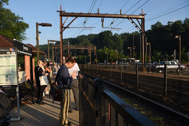 Riders wait for the train from Denville to New York Penn Station before it departs from Denville on Thursday August 9, 2018.