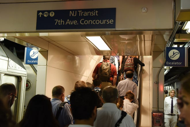 People crowd the escalator as they leave their trains at Penn Station on Thursday August 9, 2018.