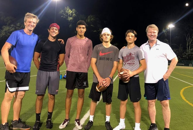 Special practice: (from left) NFL quarterback Matt Simms, Nutley football players Wayne Wittman, Eli Acosta, Justin Lucia and Matt Harbison and former Giants great Phil Simms.