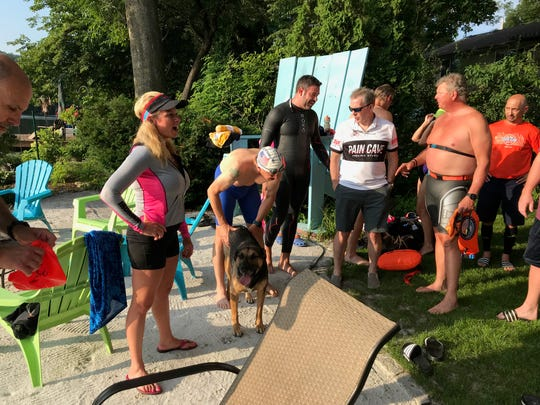 Mary Ellen Loranger gives a talk members of local triathlon groups she has organized for a swim at Crystal Lake.