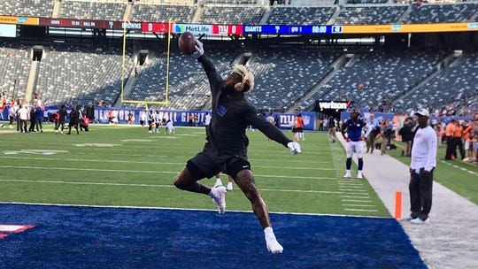 NY Giants wide receiver Odell Beckham Jr. makes a one-handed catch during pregame warmups prior to Thursday night's preseason game against the Cleveland Browns at MetLife Stadium in East Rutherford, NJ.