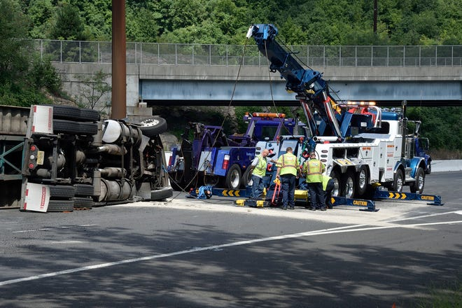 Crews work to recover a tractor-trailer that had overturned onto the median on Route 17 North near the Sharp Plaza exit in Mahwah on Thursday, Aug. 9, 2018.