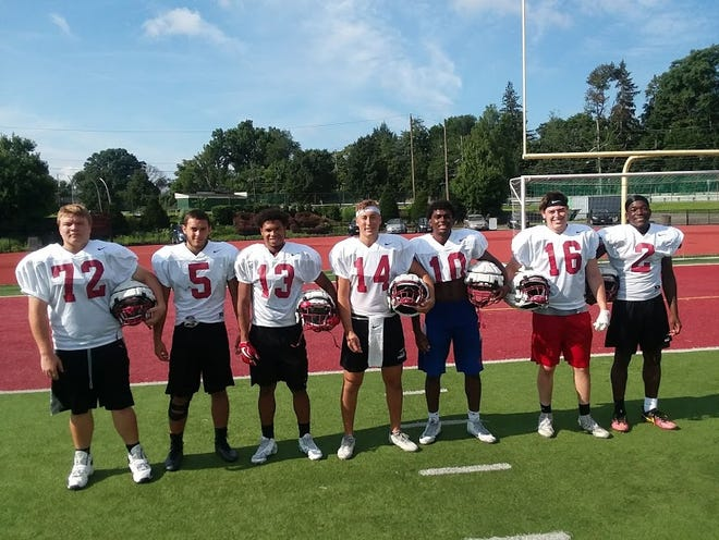 Bloomfield football captains: (from left) Xavier Gulley, Joe Orsita, Will Robinson, Kyle Tice, Andrew Terc, Dylan Coury and Brandon Holt.