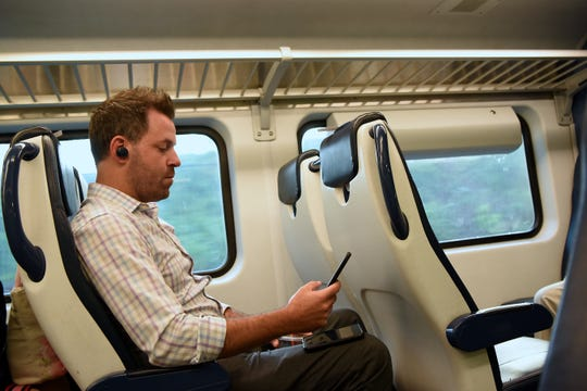Tim Leonard from Denville keeps busy on his phone during the ride to Penn Station on Thursday August 9, 2018.