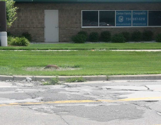 This patch of rough road on eastbound Cherry Hill Road  may create new clients for the nearby Canton Family Chiropractic.