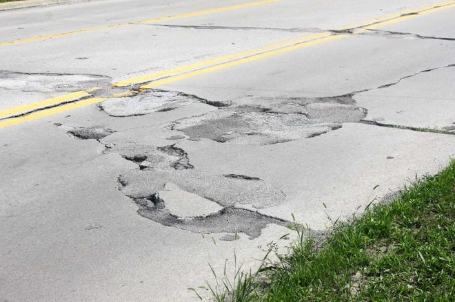 Located on Haggerty Road just south of Cherry Hill, this family of potholes has persevered through multiple patchings.