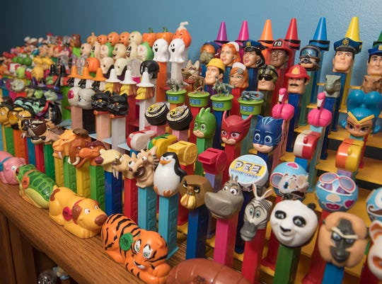 Many different PEZ dispensers are on display in Jon Hicks's collection room.