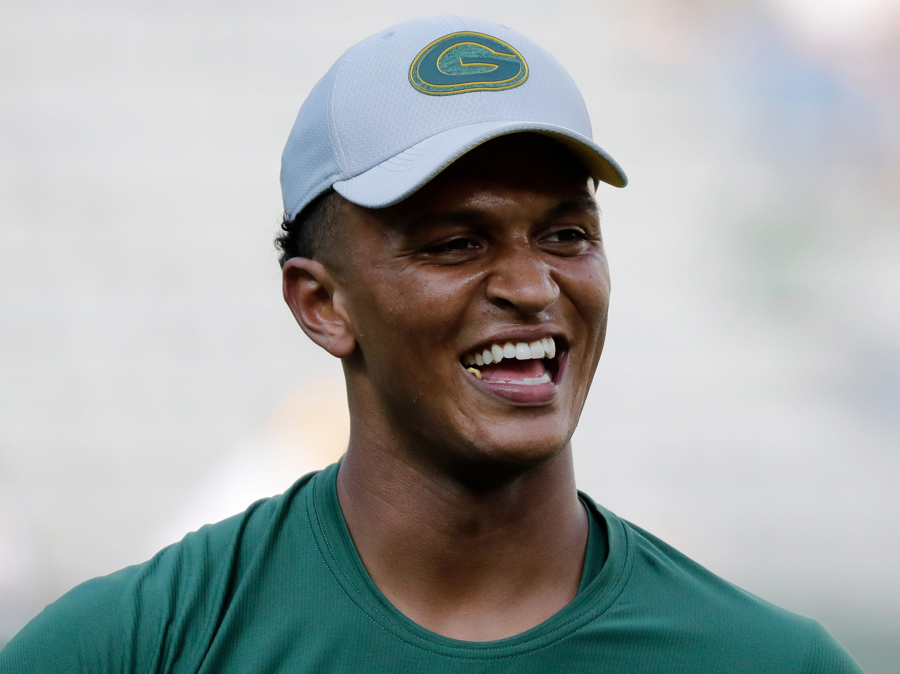 Green Bay Packers quarterback DeShone Kizer (9) warms up before a NFL preseason game at Lambeau Field on Thursday, August 9, 2018 in Green Bay, Wis.