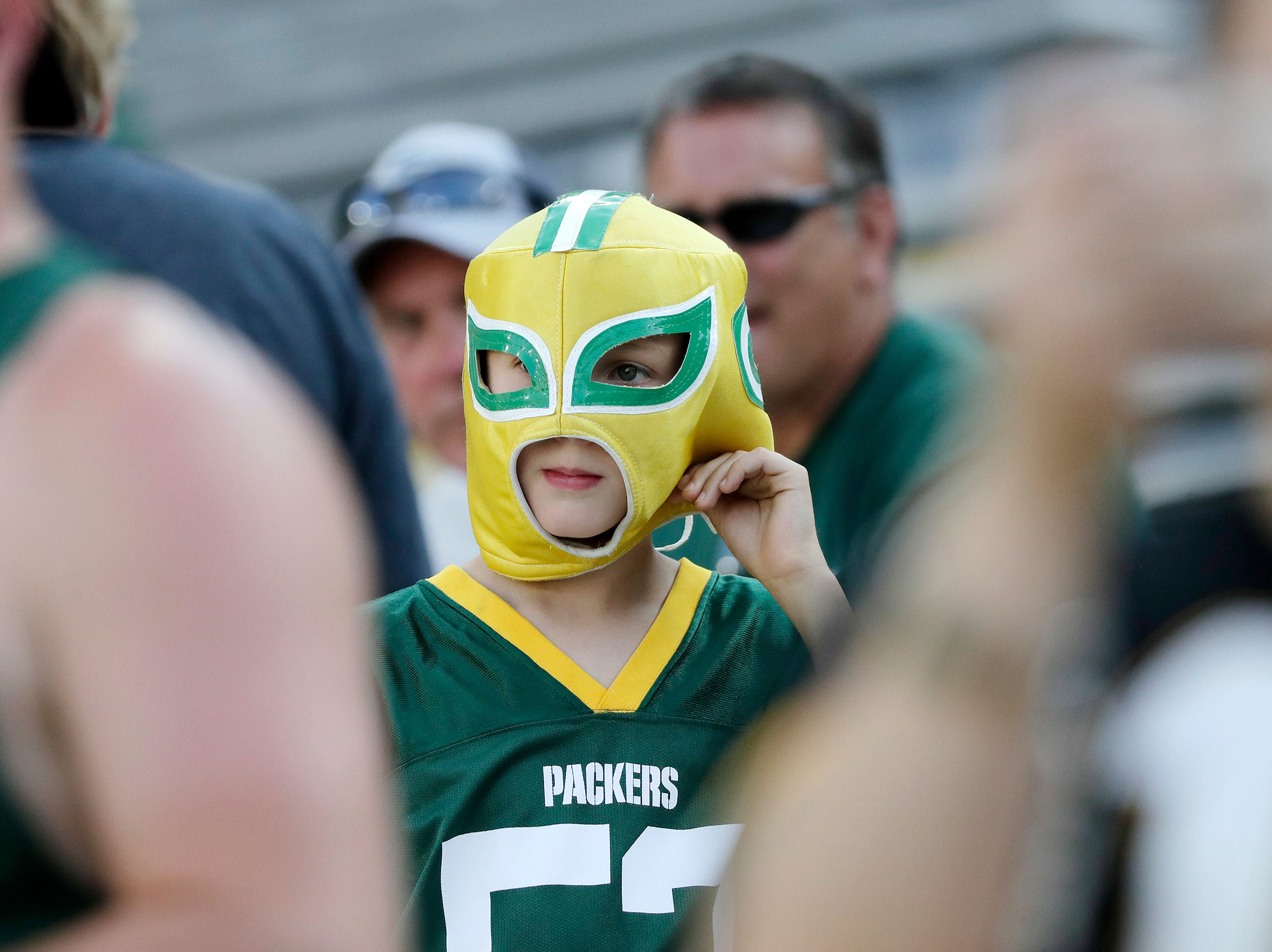 A young Packers fan watches warmups for a NFL preseason game at Lambeau Field on Thursday, August 9, 2018 in Green Bay, Wis.