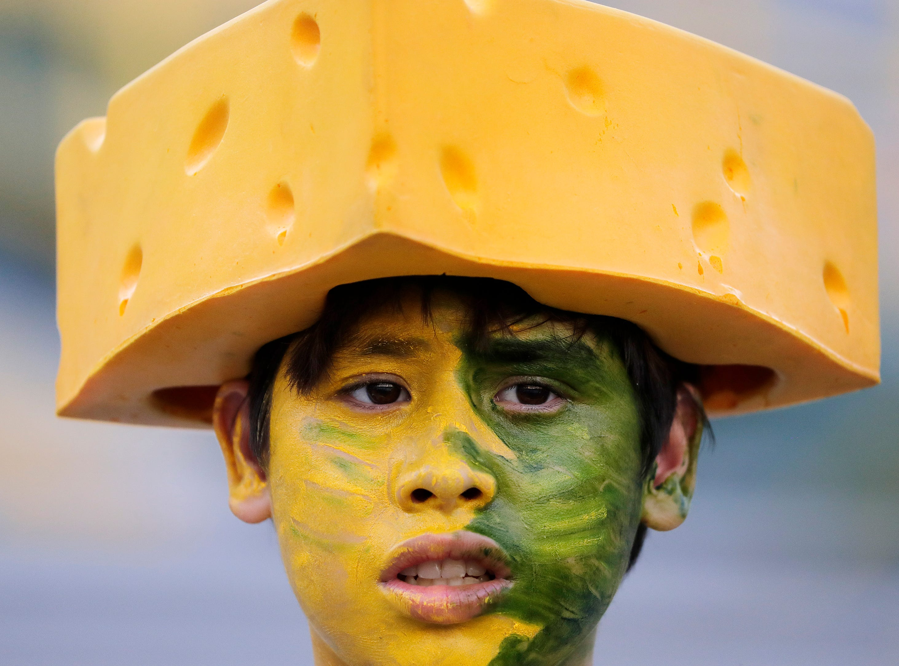 A younf Packers fan arrives for a NFL preseason game at Lambeau Field on Thursday, August 9, 2018 in Green Bay, Wis.