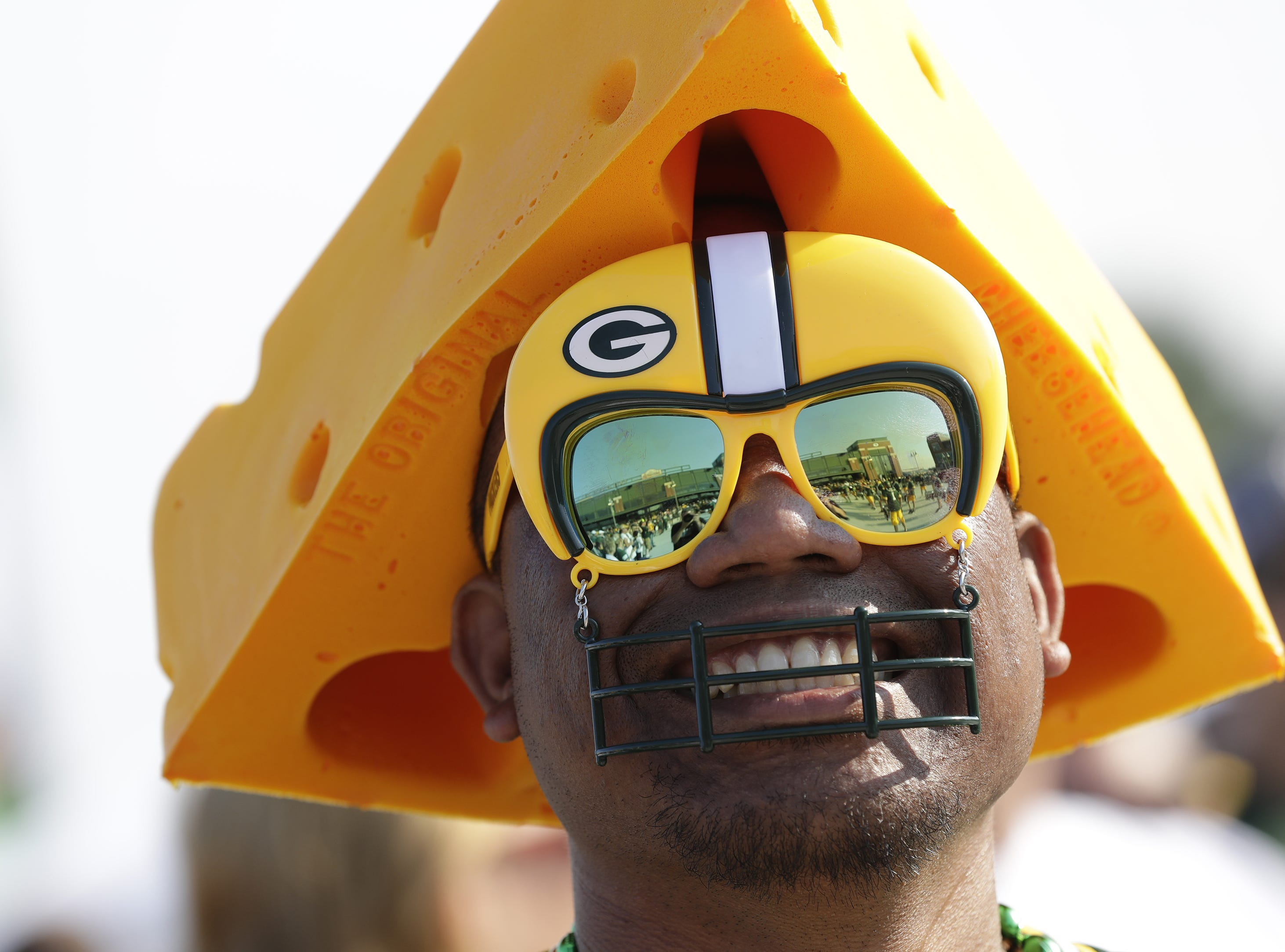 Lambeau Field is reflected in the glasses of Concord Bautista of San Diego as he listens to the Tundra Line perform prior to the Green Bay Packers playing against the Tennessee Titans Thursday, August 9, 2018, at Lambeau Field in Green Bay, Wis.  USA TODAY NETWORK-Wisconsin