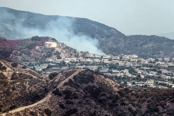 The Holy Fire burns closes to development near Lake Elsinore on Thursday, August 9, 2018.