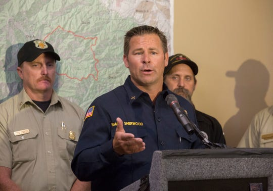 Battalion Chief for Orange County Fire Authority and Chief Fire Investigator Shane Sherwood speaks on the arrest of an arson suspect in the Holy Fire at a press conference in Irvine, California on August 8, 2018.