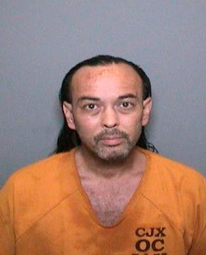 This booking video image released by the Orange County Sheriff's Department shows 51-year-old Forrest Gordon Clark, who was booked into Orange County jail in Santa Ana, Calif., Wednesday, Aug. 8, 2018. Clark was arrested in connection with the so-called Holy Fire, which has burned more than 6 square miles in the Santa Ana Mountains. Clark was booked on suspicion of two counts of felony arson, and one count each of felony threat to terrorize and misdemeanor resisting arrest. (Orange County Sheriff's Department via AP)