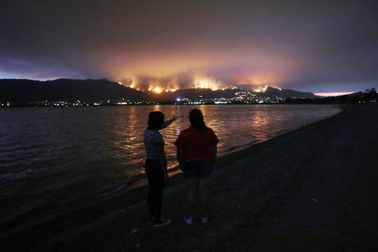 LAKE ELSINORE, CA - AUGUST 08:  People watch as the Holy Fire burns in Cleveland National Forest on August 8, 2018 in Lake Elsinore, California. The fire has burned at least 6,200 acres and destroyed twelve structures.  (Photo by Mario Tama/Getty Images)