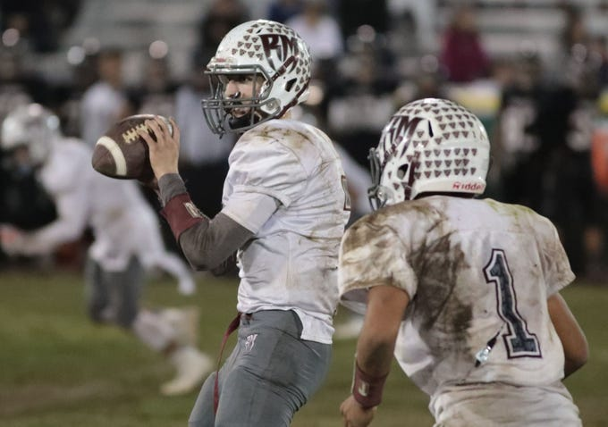 Rancho Mirage quarterback David Talley carries the ball against Katella in the 4th quarter during the CIF Southern Section Division 11 semifinals played in Anaheim, CA on Friday, November 24, 2017.