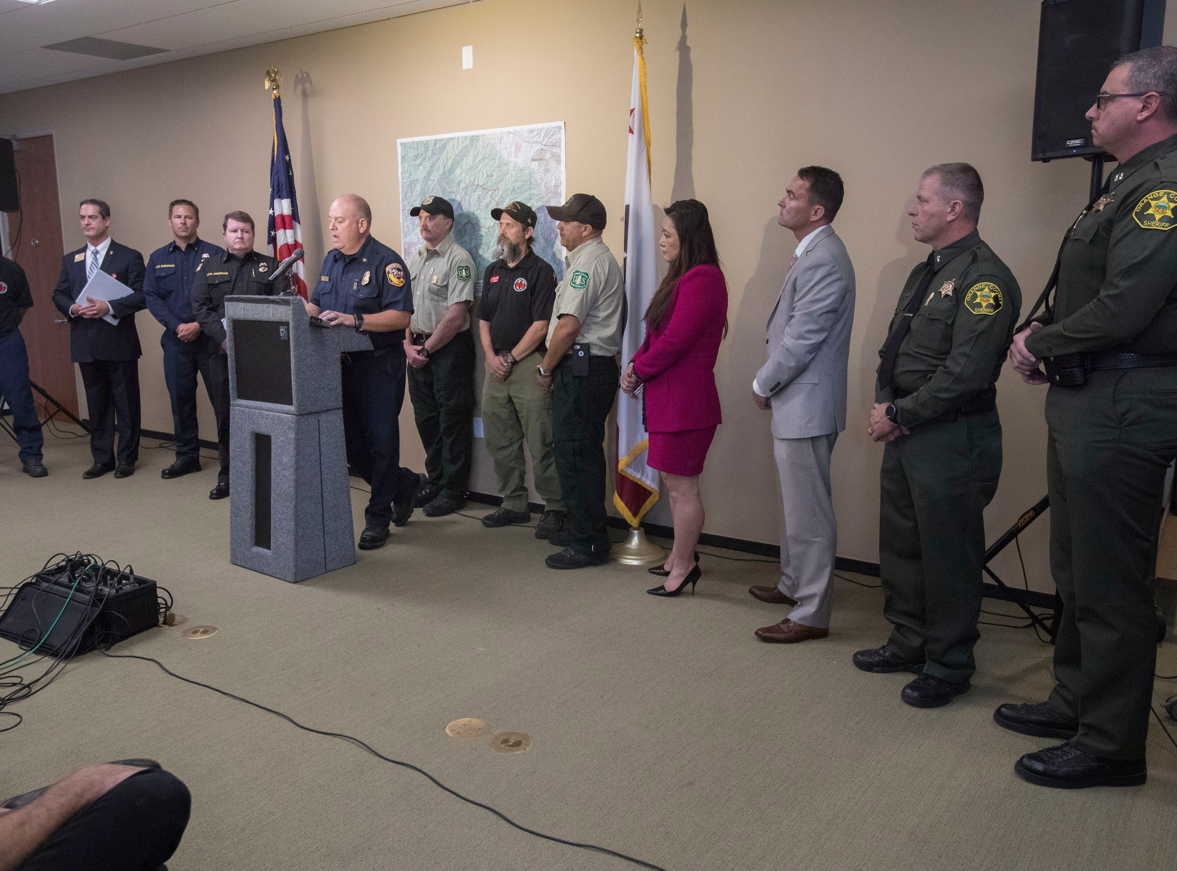 Government officials speak on the arrest of an arson suspect in the Holy Fire at a press conference in Irvine, California on August 8, 2018.