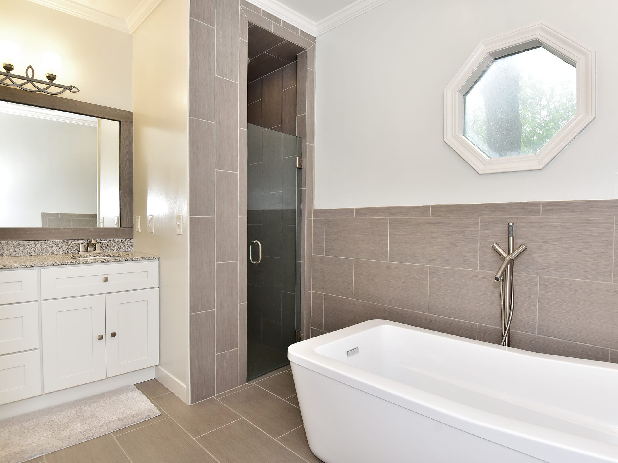 2474 Semur Rd., the master bath is a chic, spa-like space.