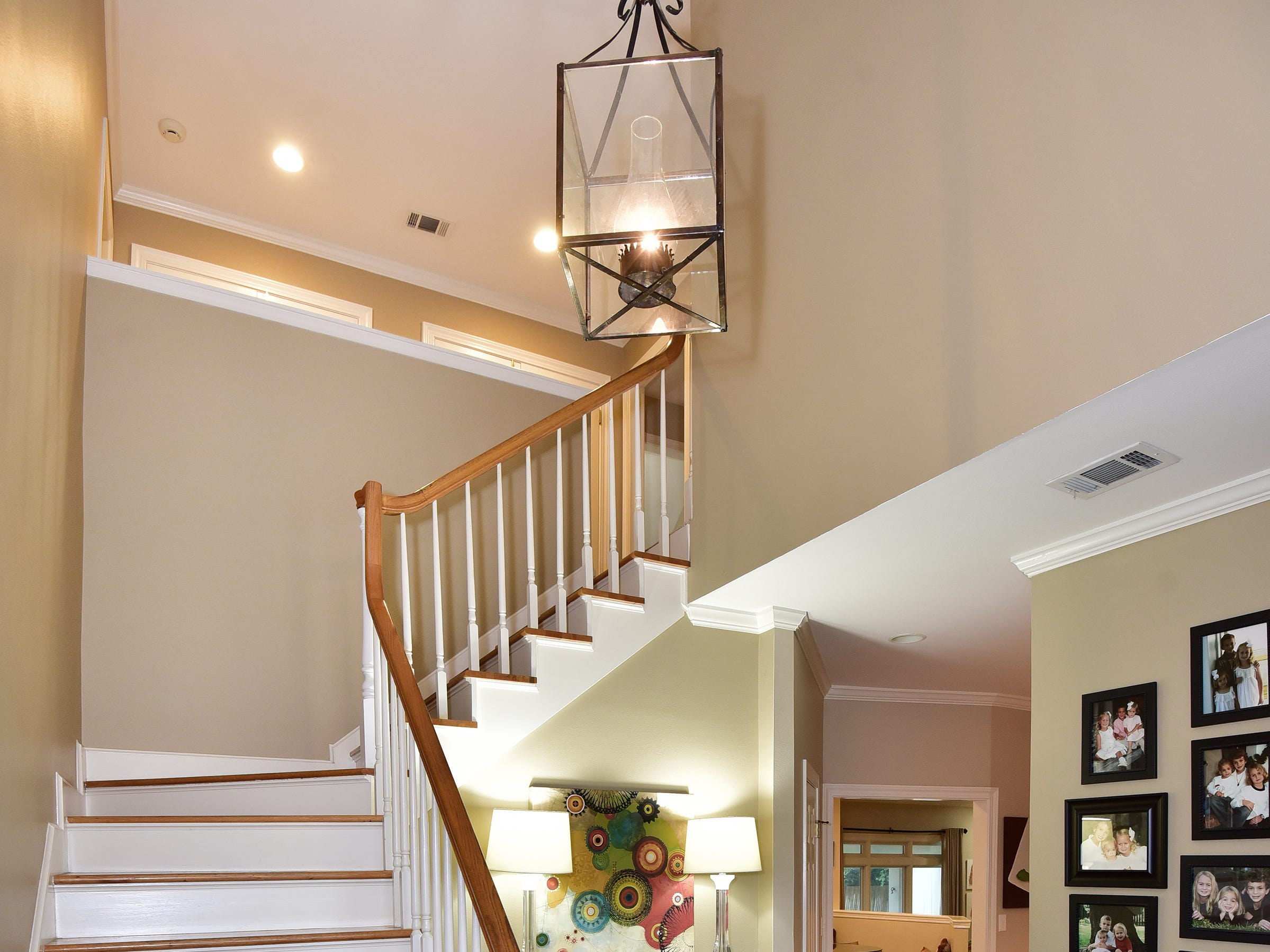 2474 Semur Rd., the foyer flows into the home and offers stairs to the second story.