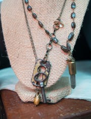 Unique jewelry made from repurposed finds like a keyhole and key at the Ann David Gallery off Cervantes Street in East Hill, Pensacola on Wednesday, August 8, 2018