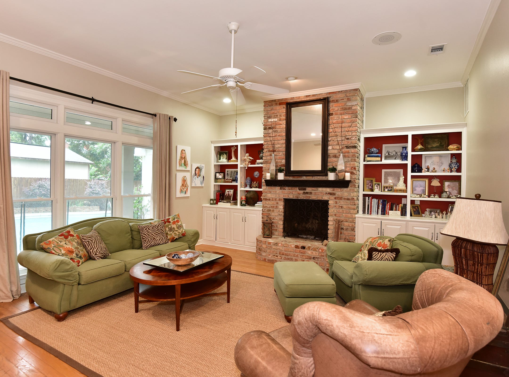 2474 Semur Rd., the family room includes a fireplace and overlooks the pool.