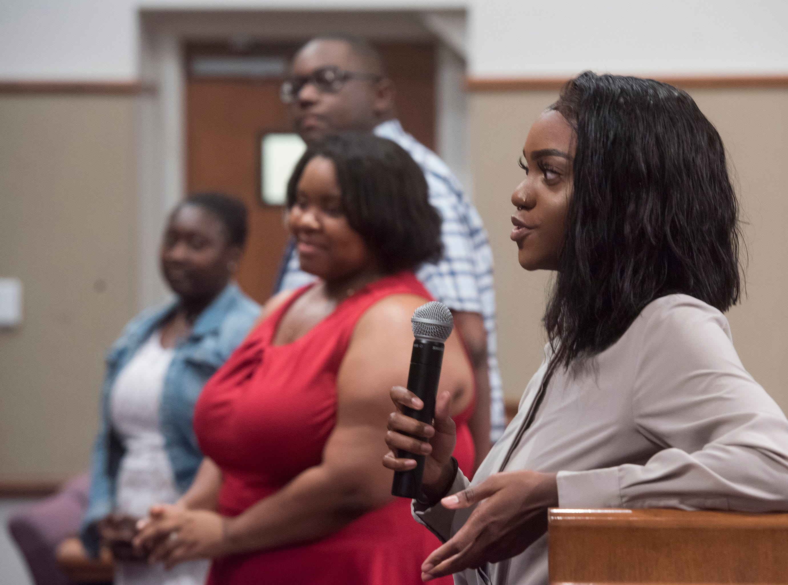Faith Glaze, right, praises Escambia County for its student internship program during a ceremony in the commission chambers to recognize the young workers Thursday, Aug. 9, 2018.