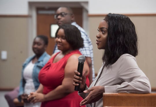Faith Glaze, right, praises Escambia County for its Youth Employment Program during a ceremony for the graduates on Thursday.