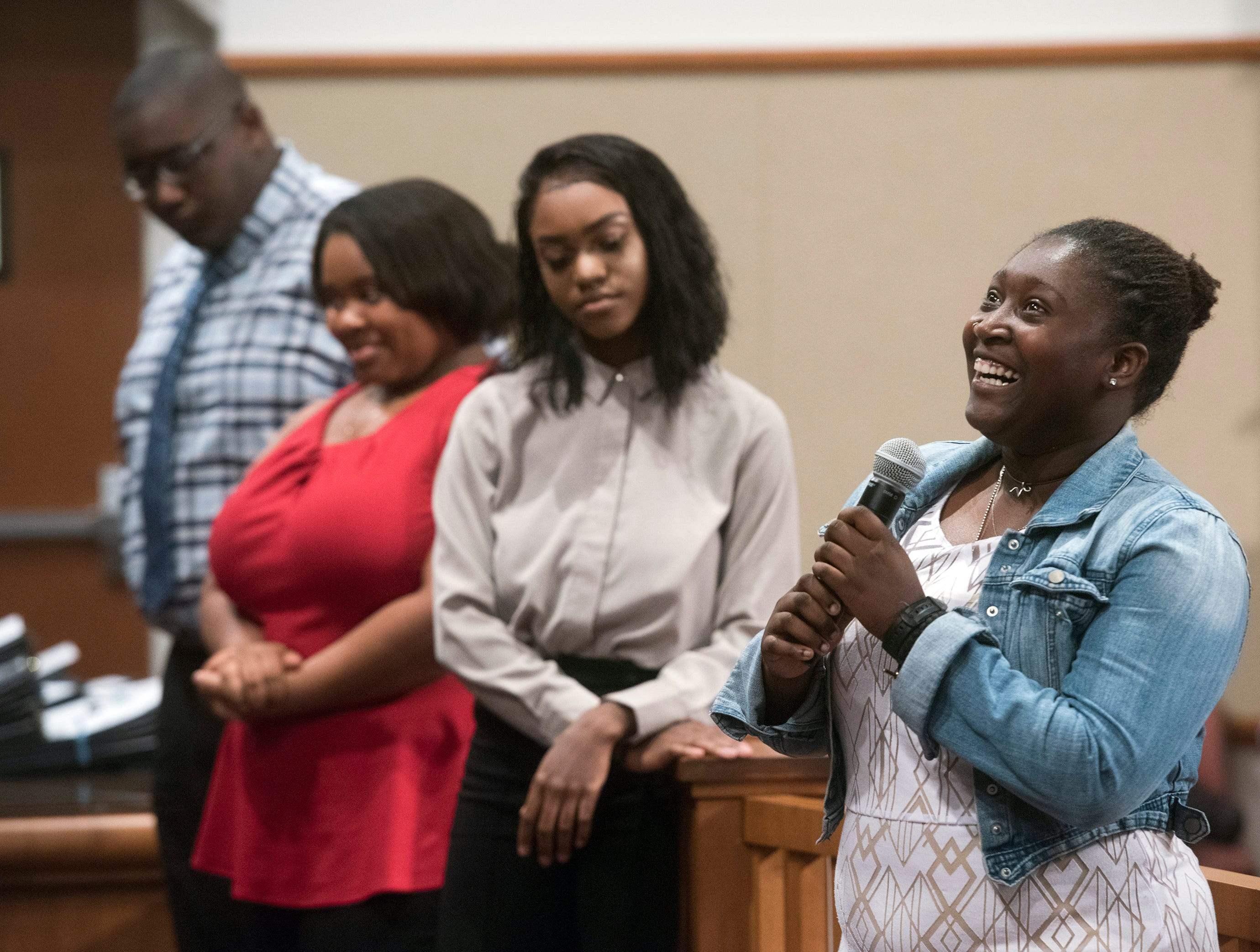 Destinee Pagett, right, praises Escambia County for its student internship program during a ceremony in the commission chambers to recognize the young workers Thursday, Aug. 9, 2018.