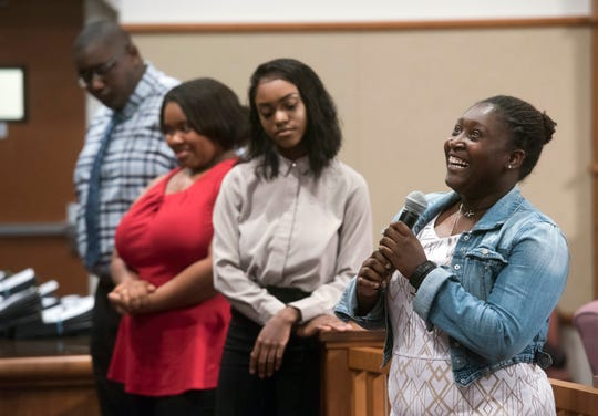 Destinee Pagett, right, praises Escambia County for its Youth Employment Program during a ceremony for the graduates on Thursday.