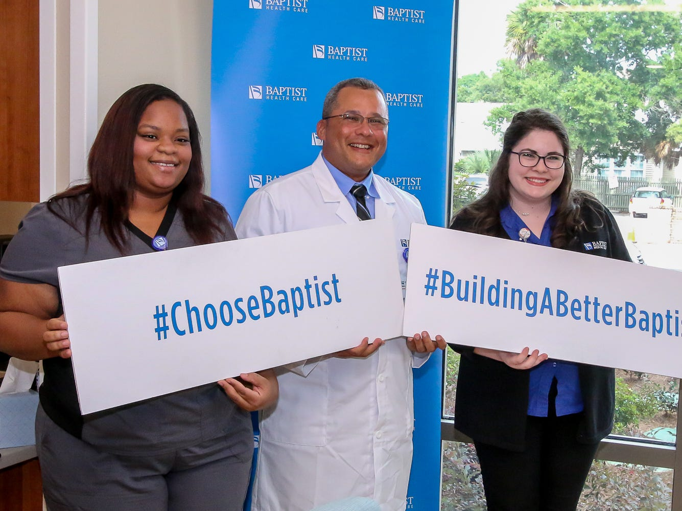 Employees Katrease Loveless, left, and Rachel Turley, right, pose for a photo with board-certified physician assistant Jean Bernard Le Gall, PA-C, during an open house for the new Convenient Care Southtowne walk-in clinic in downtown Pensacola on Thursday, August 9, 2018. Located across from the YMCA near the S. Tarragona intersection at 190 E. Intendencia St., the clinic will be open from 8 a.m. to 5 p.m. Monday through Friday.