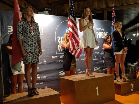 Kennedy Hansen (center) of Milton stands atop the podium after her first-place finish in the overall competition at the International Waterski and Wakeboard Federation World Junior Waterski Championships in Spain.