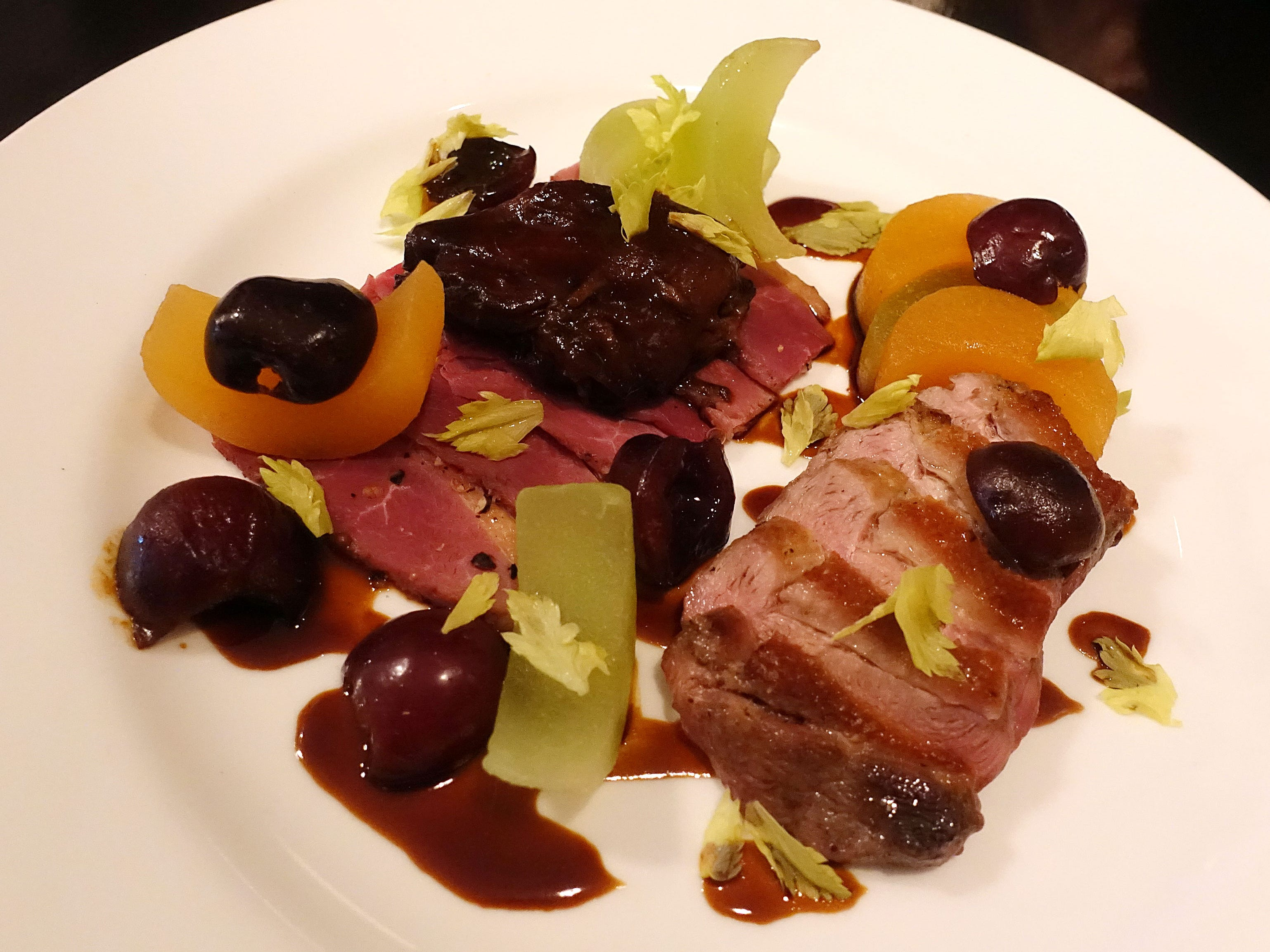 Duclair duck with seared breast, pastrami, braised leg, cherry, arugula, melon and hibiscus at Confluence in Carefree.